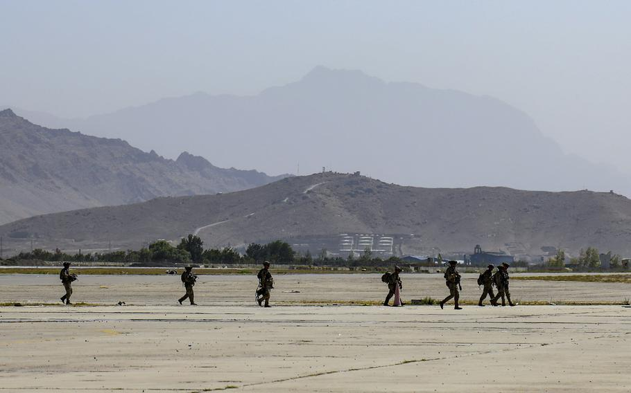 Paratroopers assigned to the 1st Brigade Combat Team, 82nd Airborne Division conduct security operations as they continue to help facilitate the evacuation at Hamid Karzai International Airport in Kabul, Afghanistan on Wednesday, Aug 25, 2021.