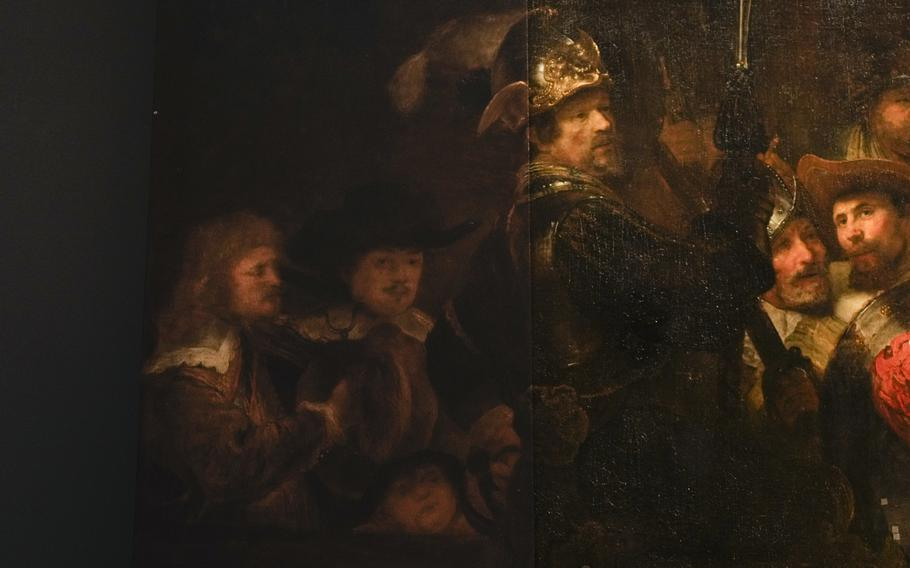 Detail of the Night Watch's left side, showing how Rembrandt's biggest painting just got bigger with the help of artificial intelligence in Amsterdam, Netherlands, Wednesday, June 23, 2021. The Dutch national museum and art gallery reveals findings from a long-term project to examine in minute detail Rembrandt van Rijn's masterpiece the Night Watch.
