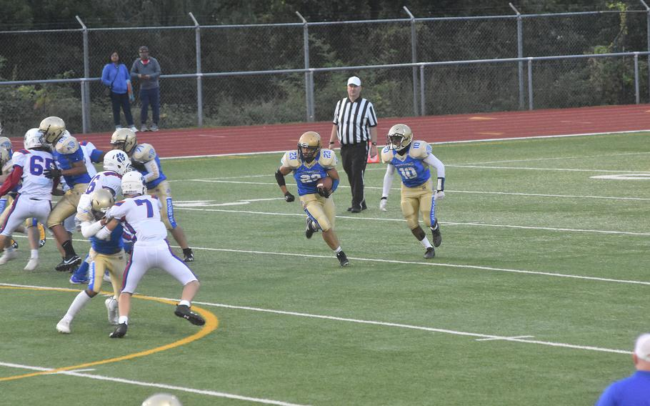 Wiesbaden running back Nick Cardona attemps to get around the Ramstein defense on Friday, Sept. 17, 2021,  during a football game in Wiesbaden.
