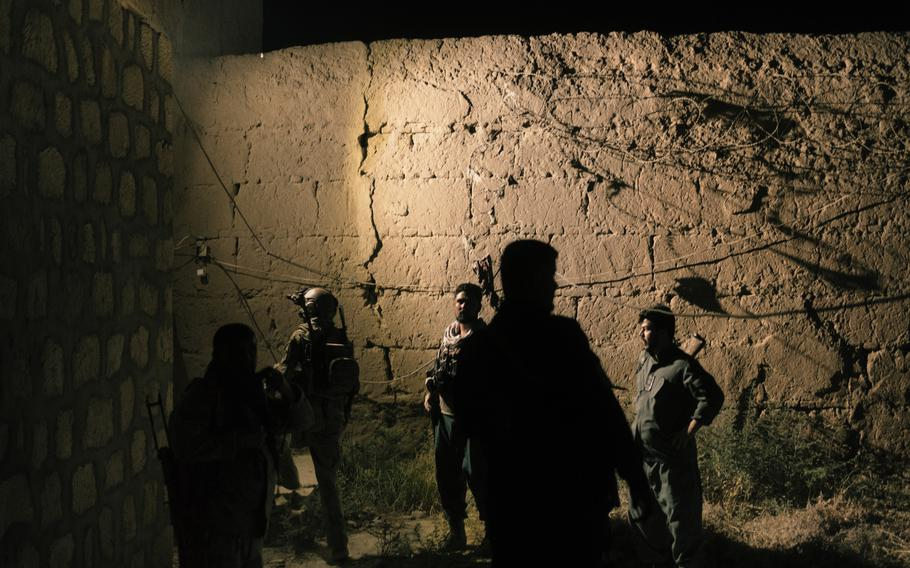 Members of the Afghan special forces check the perimeter of Kunduz prison. The security services received information signaling that the Taliban might attack the prison during the night to free the prisoners.