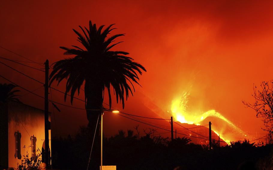 A volcano continues to spew out lava on the Canary island of La Palma, Spain in the early hours of Sunday, Oct. 10, 2021.