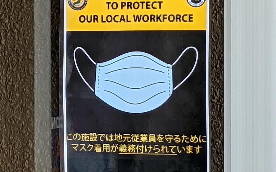 A sign warns customers to wear masks at a Navy Exchange on Yokosuka Naval Base, Japan, Friday, May 28, 2021.