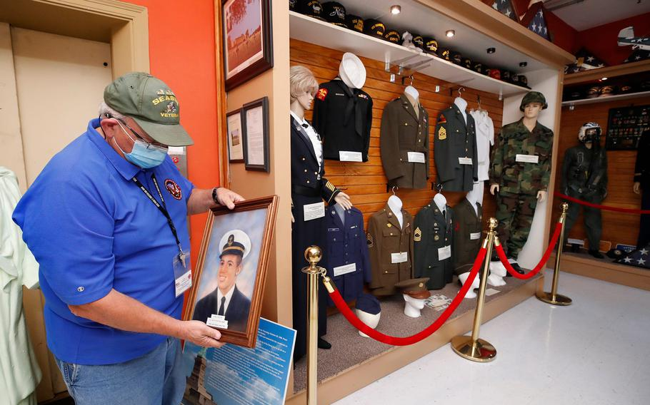 The Veterans Museum and Education Center has finally found a permanent home in the historic Cornelia Young Library in Daytona Beach.  Pictured is museum volunteer Richard Lyons getting artifacts ready for the move out of the museum's old Beach Street location last year, when the nonprofit moved to Holly Hill.