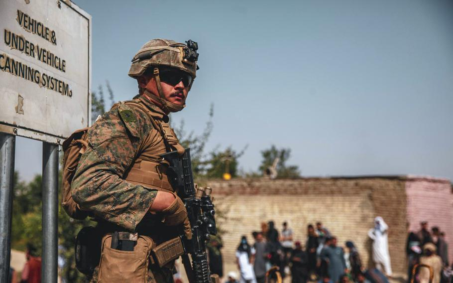 A Marine with the 24th Marine Expeditionary Unit provides security during an evacuation at Hamid Karzai International Airport, Kabul, Afghanistan, Aug. 18, 2021.