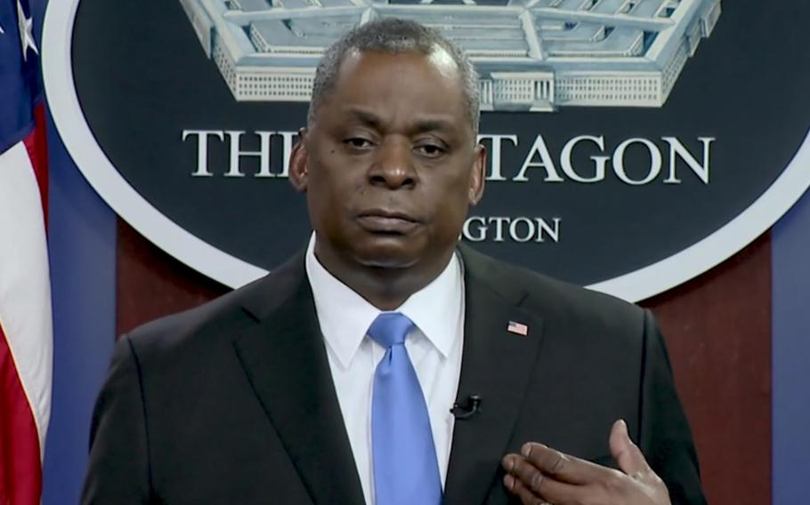 U.S. Defense Secretary Lloyd Austin speaks to U.S. service members about the coronavirus vaccine in this screengrab of a video posted online Wednesday, Feb. 24, 2021, by the Pentagon.
