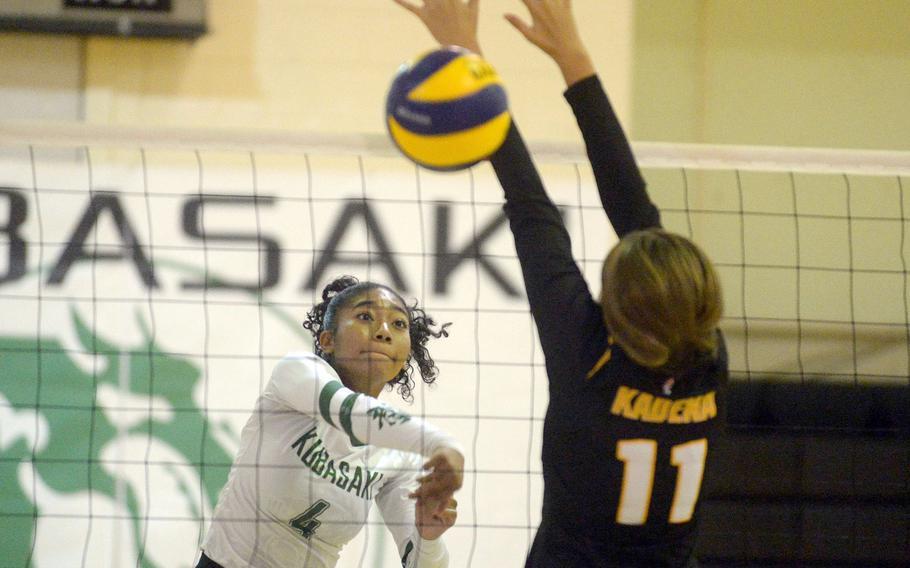 Kubasaki's Risha McGriff spikes past Kadena's Presley Pearce during Thursday's Okinawa volleyball match.