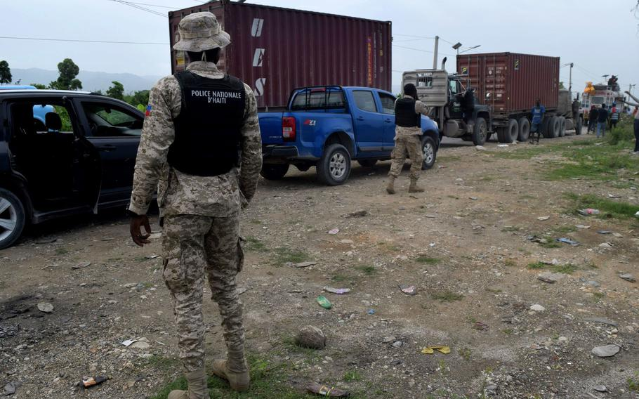 Haitian National Police provide protection to an aid convoy offering earthquake relief in southern Haiti.