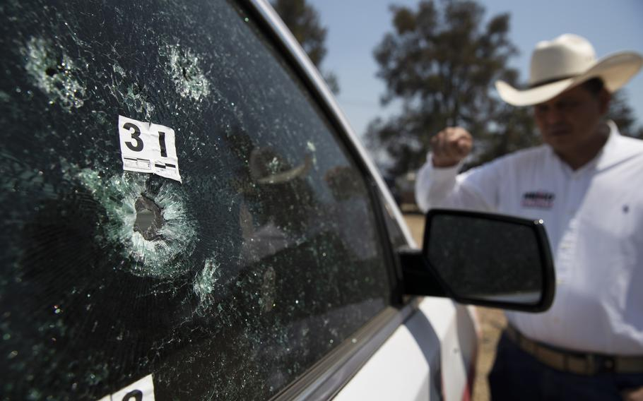 Mayoral candidate Guillermo Valencia shows in Morelia, Michoacan state, Mexico, on May 22, 2021, the bullet-riddled vehicle he was driving when armed men attacked. Gunmen near the town of Tepalcatepec, Michoacan, wounded two members of the Mexican National Guard according to reports on Wednesday, Sept. 15.