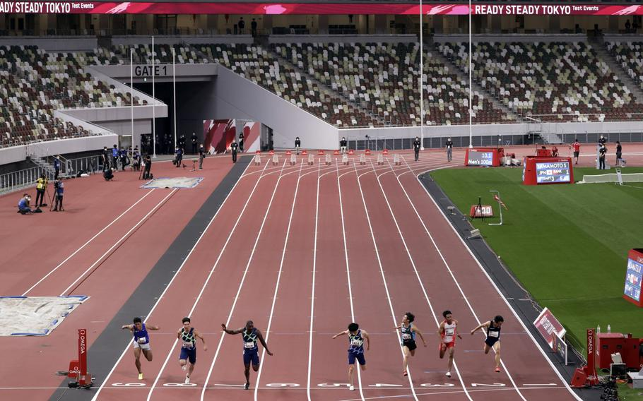 Athletes compete during an Olympics test event at the National Stadium in Tokyo on May 9.