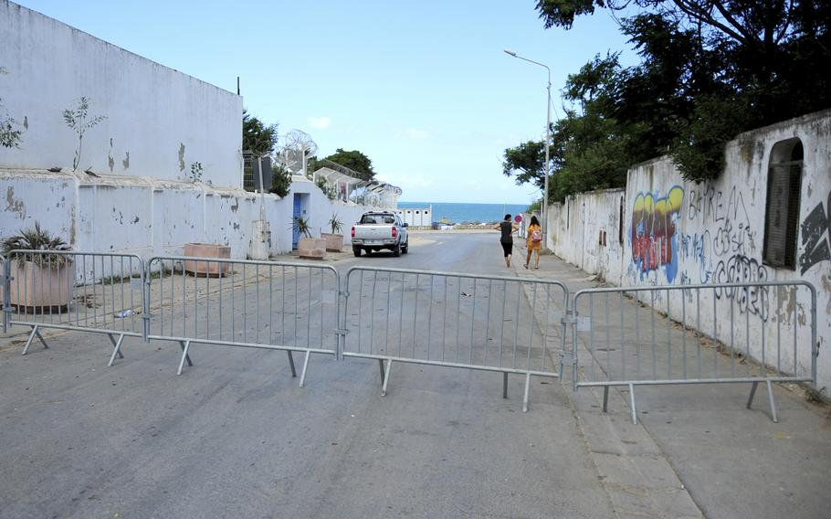 The access road to the beach is closed due to reinstated COVID-19 restrictions in La Marsa, Tunisia, Saturday.