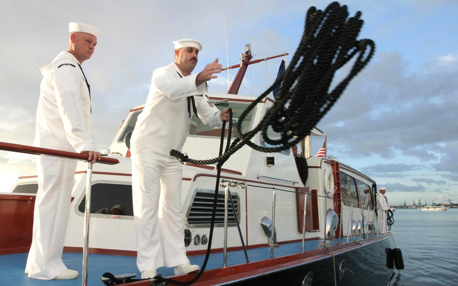The admiral's barge moors at the USS Arizona Memorial during the 62nd commemoration of the Dec. 7, 1941, attack on Pearl Harbor on Dec. 7, 2003. A 2019 fire that started in an electrical power area resulted in its total loss, damaged two other VIP boats and cost nearly $1.7 million in repair and replacement costs, theNavysaid.