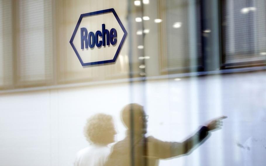 A company logo hangs on the wall at the Roche Holding headquarters in Basel, Switzerland, on April 26, 2018.