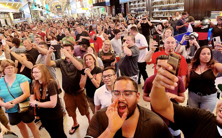 A crowd gathers at Las Vegas's Fremont Street area to watch a midnight concert celebrating the lifting of pandemic restrictions June 1.