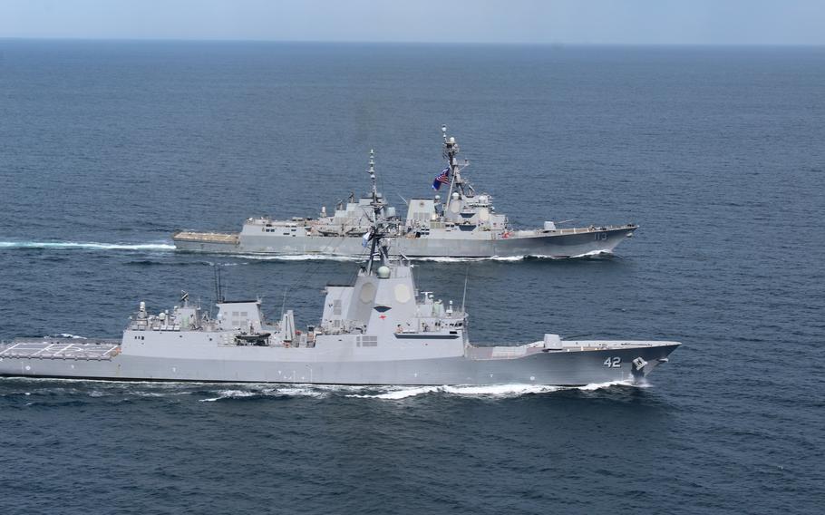 Australian Hobart-class air warfare destroyer HMAS Sydney (DDG 42) and Arleigh Burke-class destroyer USS John Finn (DDG 113) conduct a group sail in the waters off the coast of Southern California, April 1, 2021.