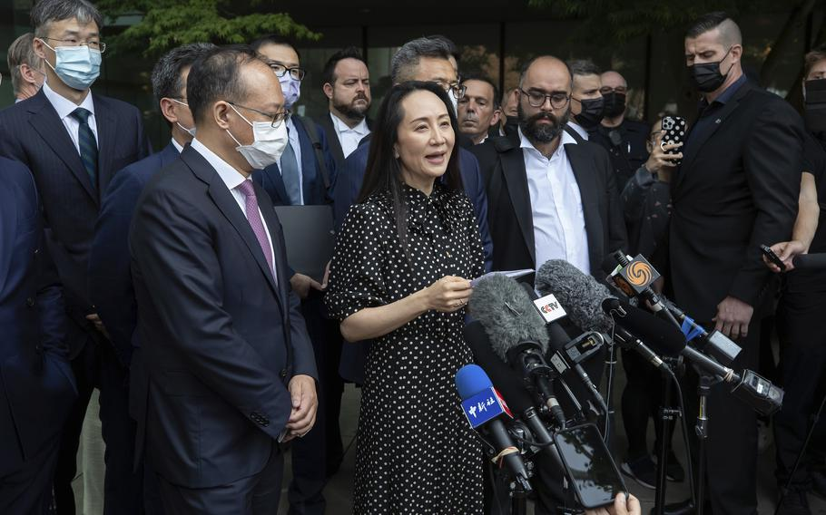 Meng Wanzhou, chief financial officer of Huawei, reads a statement outside B.C. Supreme Court in Vancouver, British Columbia, Friday, Sept. 24, 2021.