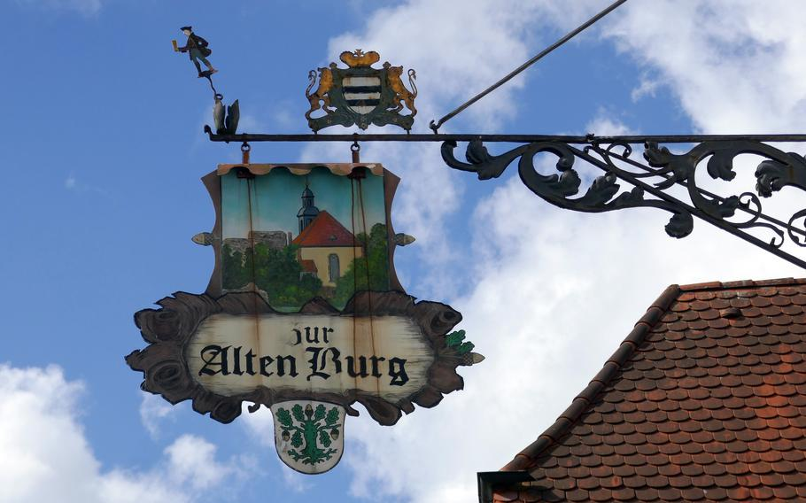 The old-fashioned sign for the restaurant Zur Alten Burg in Dreieichenhain, Germany. A the foot of the town's castle, it serves German and Hessian specialties. It's a popular place, but doesn't open until 5 p.m.