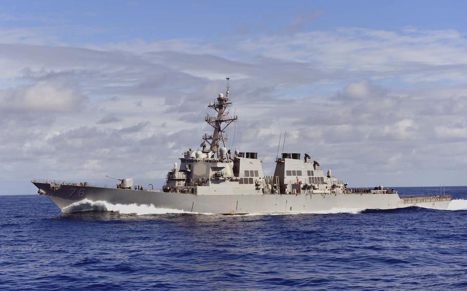 The guided-missile destroyer USS Higgins, shown here in the Western Pacific in 2013, arrived at Yokosuka Naval Base, Japan, with the destroyer USS Howard on Aug. 16, 2021.