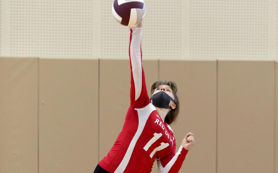 Nile C. Kinnick's Kathryn Withers serves against Matthew C. Perry during Saturday's Japan girls volleyball match. The Red Devils won in straight sets.