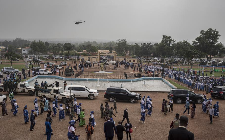 Guests leave the national assembly building following Central African Republic President Faustin-Archange Touadera's inaugural ceremony in Bangui on March 30, 2021. Touadera was sworn in for a second term amid mounting threats to his presidency.