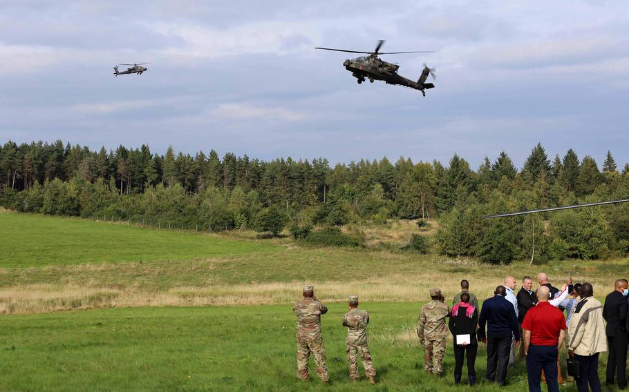 AH-64D Apache attack helicopters fly during a live-fire aerial gunnery on Grafenwoehr Training Area, Germany, Sept. 21, 2021. African leaders attending the African Land Forces Colloquium observed the gunnery while learning about what capabilities are available at the training area.