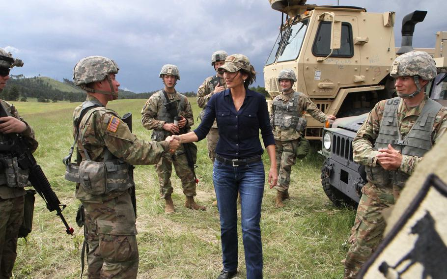 South Dakota National Guard Soldiers from the 153rd Engineer Battalion of Huron greet Gov. Kristi Noem at Barnes Canyon Camp during Golden Coyote training exercise in Custer State Park, S.D., June 14, 2019. Noem announced Tuesday, June 29, 2021, that she will join a growing list of Republican governors sending law enforcement officers to the U.S. border with Mexico.