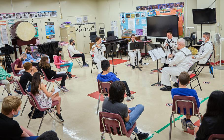 Lanham Elementary School listen to a performance by members of the 7th Fleet Band during a STEAM event at Naval Air Facility Atsugi, Japan, May 27, 2021.