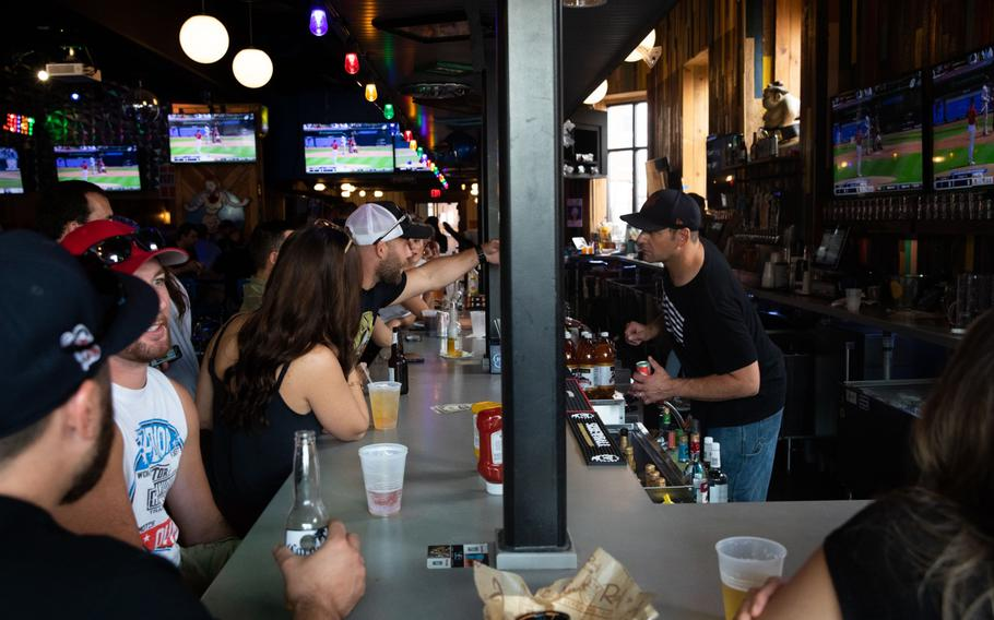 Customers at a bar in Detroit on Aug. 8, 2021.