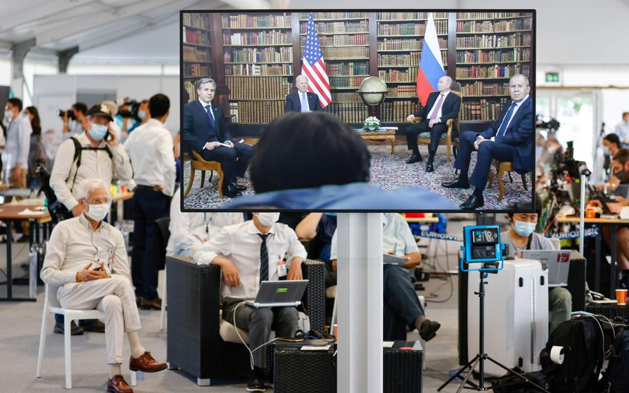 Journalists watch a broadcast feed of the start of the meeting between Vladimir Putin, Russia's president; U.S. President Joe Biden; Sergei Lavrov, Russia's foreign minister, and Antony Blinken, U.S. secretary of state, at the start of the U.S.-Russia summit in Geneva on June 16.