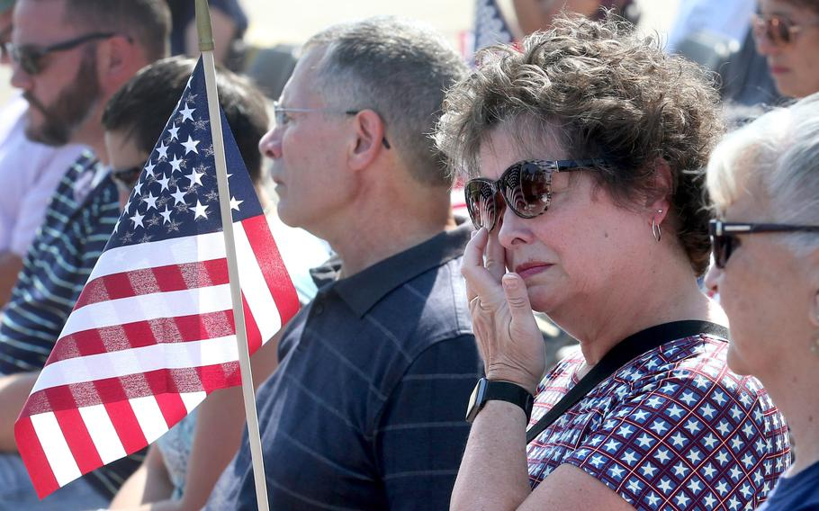 Kathy Patron holds the American flag and wipes away a tear during a 10th anniversary memorial service for her son, Marines Sgt. Daniel Patron, in Perry Township on Saturday, Aug. 21, 2021. Patron died Aug. 6, 2011, while defusing a roadside bomb while serving in Afghanistan.