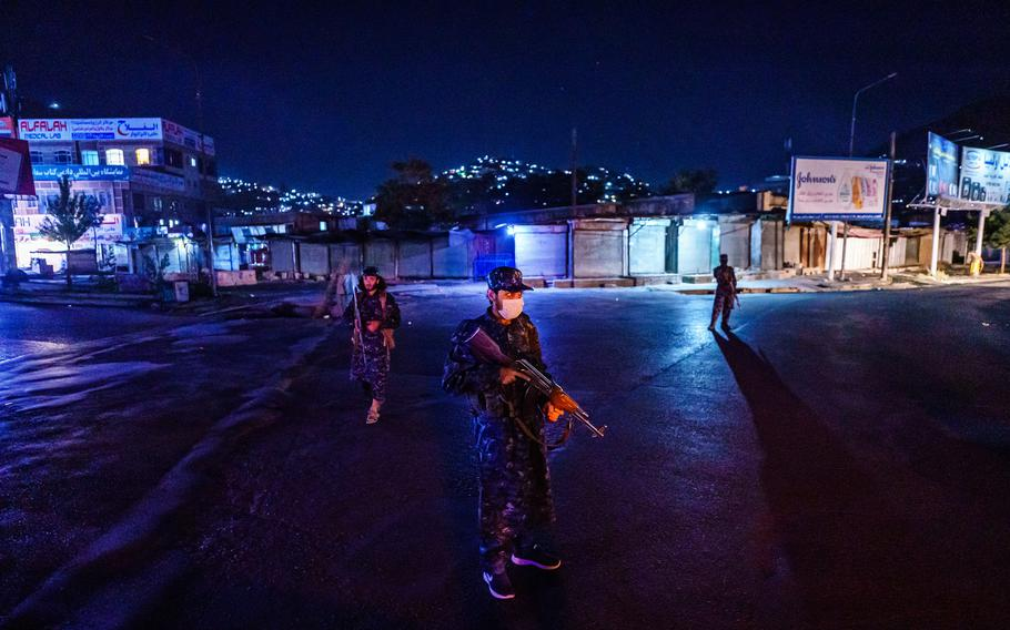 Taliban fighters in their new uniforms station themselves at a large traffic junction for a nightly security checkpoint, in Kabul, Afghanistan, Sunday, September 5, 2021.
