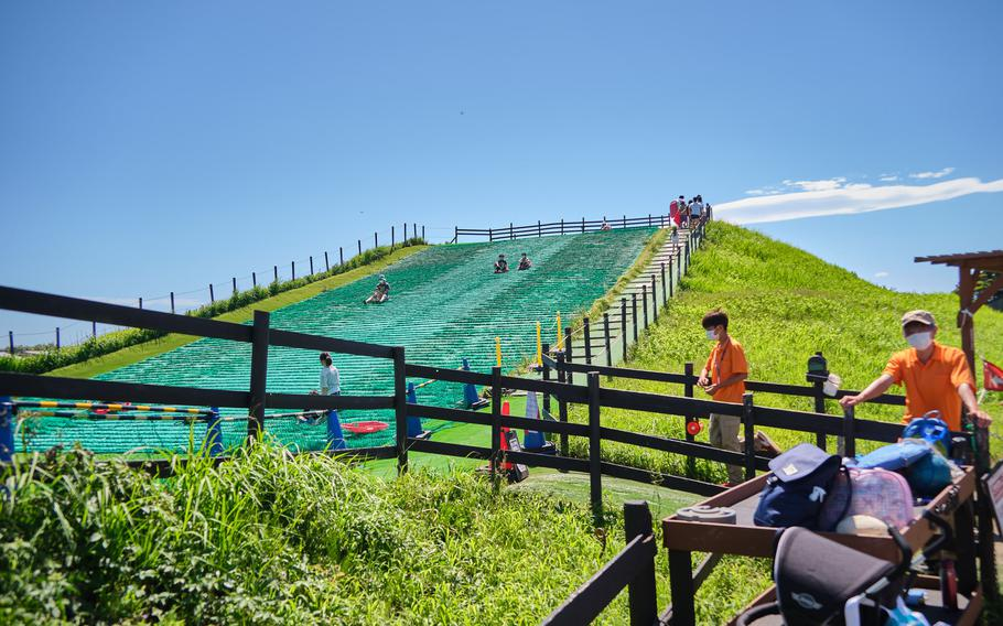 Grass-sledding is just one of many activities available at Soleil Hill Park near Yokosuka Naval Base, Japan.