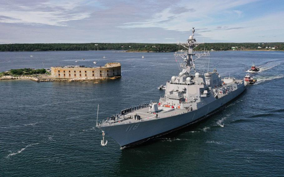 The future USS Daniel Inouye (DDG 118) transits the Kennebec River, sailing away from General Dynamics Bath Iron Works shipyard in Bath, Maine, on Oct. 4. The ship will be in Newport on Friday.