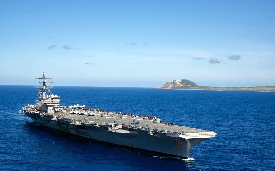 The aircraft carrier USS Ronald Reagan sails near Iwo Jima, known in Japan as Iwo To, in the Philippine Sea, May 22, 2021.