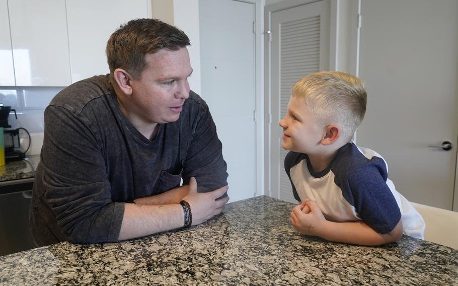 Associated Press investigative reporter James LaPorta and his son Joel, 5, sit at their home, Tuesday, Sept. 7, 2021, in Boca Raton, Fla. LaPorta recalls a boy he encountered in Afghanistan back in 2013 while serving as a Marine.