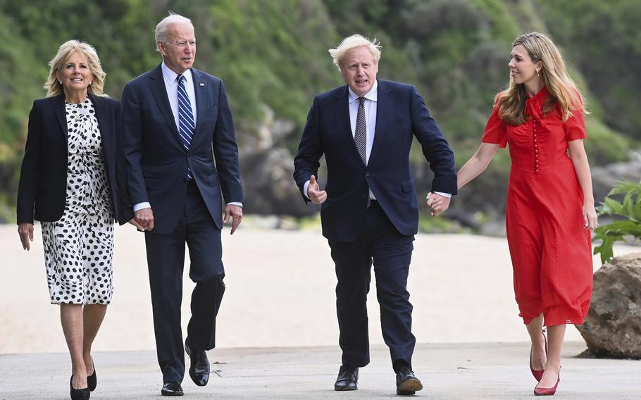 Britain's Prime Minister Boris Johnson, his wife Carrie Johnson and U.S. President Joe Biden with first lady Jill Biden walk outside Carbis Bay Hotel, Carbis Bay, Cornwall, Britain, ahead of the G7 summit, Thursday June 10, 2021.