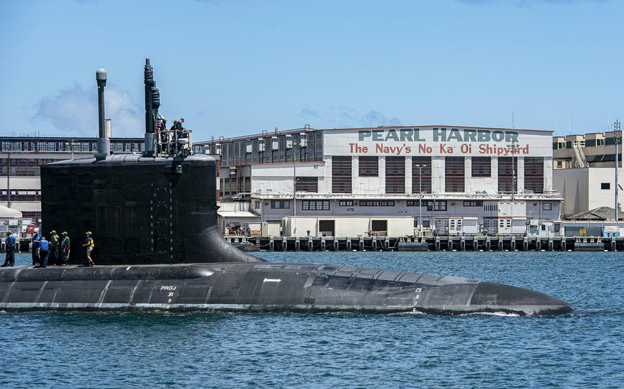 A Virginia-class fast-attack submarine departs Pearl Harbor Naval Shipyard in Hawaii, May 10, 2020. A Navy nuclear engineer and his wife have been charged with repeatedly trying to pass along secrets on the design, operations and performance of Virginia-class nuclear submarine reactors, according to court documents.