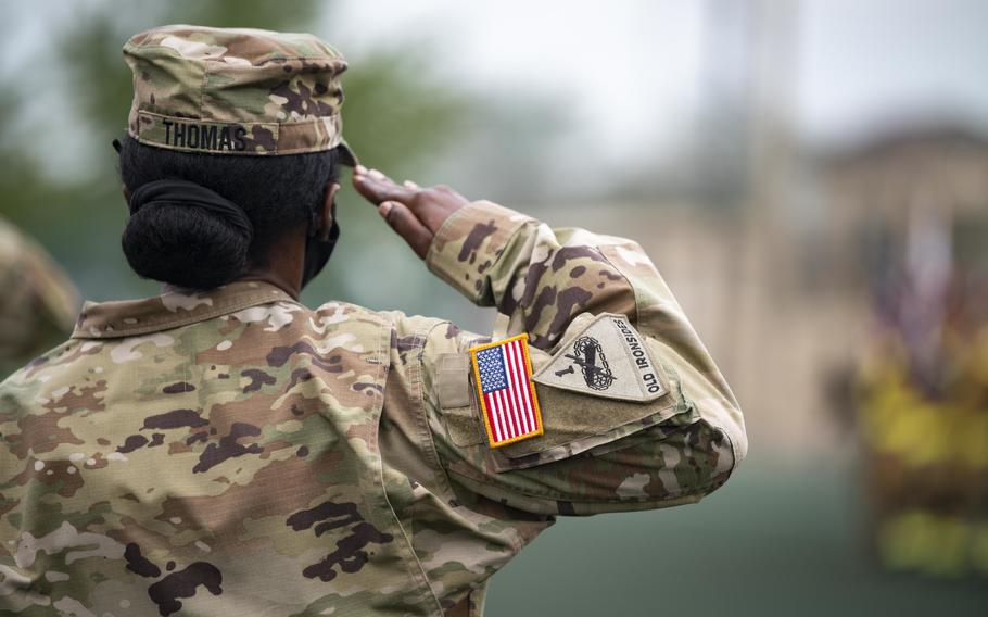 A soldier assigned to Kunsan Air Base, South Korea, salutes on Sept. 10, 2021.