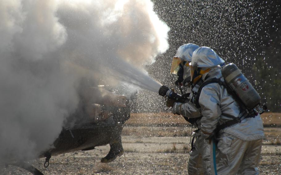 Firefighters use extinguish a helicopter fire during a training exercise in 2007.