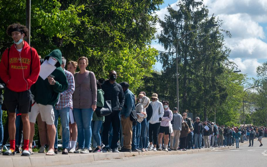 Hundreds of families line up for the COVID-19 vaccine at Patch Barracks in Stuttgart, Germany, May 22, 2021.  Nearly three-quarters of the U.S. Army community in Europe and Africa are fully vaccinated and 77% of 16- and 17-year-old military children overseas have been inoculated against the coronavirus, health officials say.