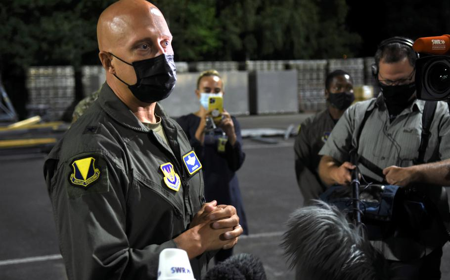 Brig. Gen. Josh Olson, 86th Airlift Wing commander at Ramstein Air Base, Germany, speaks to reporters on Friday, Aug. 20, 2021, about how Ramstein is prepared to temporarily support thousands of evacuees from Afghanistan. Hundreds arrived Friday night.