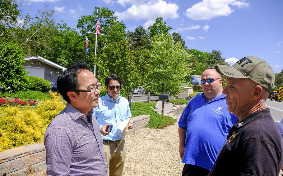 Marty Weber, right, the owner of the land talks to Rep. Andy Kim, left, as Just Believe director Paul Hulse, 2nd from right, listens as they stand by some of 36 acres being donated.