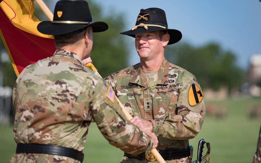 Lt. Gen. Pat White, III Corps commanding general, passes command to Maj. Gen. John B. Richardson, 1st Cavalry Division commanding general, in a ceremony July 21 here.