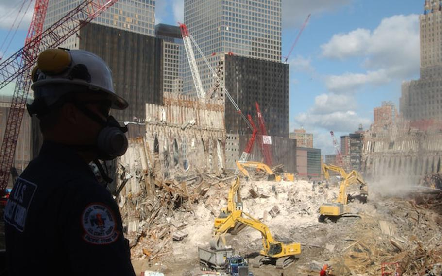 Petty Officer Ray Brown from the Coast Guard Pacific Strike Team looks out at Ground Zero in New York City on Sept. 17, 2001. The Coast Guard along with the EPA is monitoring personnel and air safety concerns at Ground Zero.