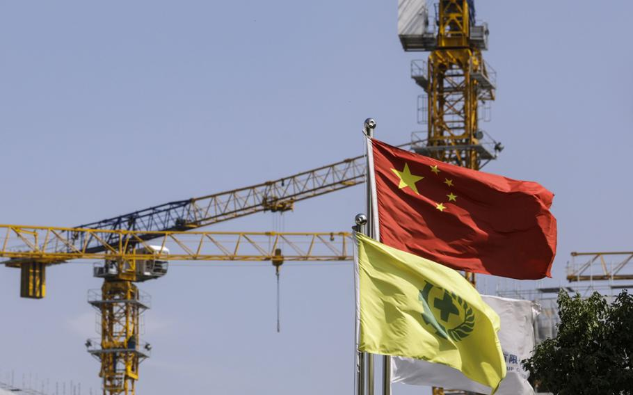 A Chinese flag is flown near a construction site for residential buildings in the Fengxian district of Shanghai on Oct. 17, 2020.