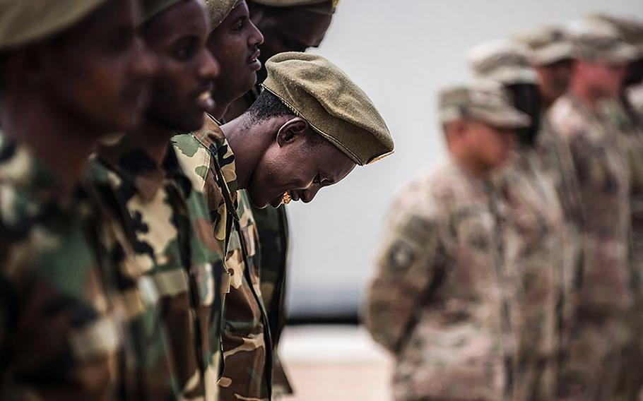 36p na                    In an August, 2018 photo, Somali national army soldiers stand in formation, waiting to receive certificates of completion at a logistics course graduation ceremony. Soldiers from Somalia's advanced infantry Danab battalion spent 14 weeks training with the U.S. 10th Mountain division on the importance of logistical operation as well as the operation and maintenance of heavy equipment. EVAN PARKER/DOD