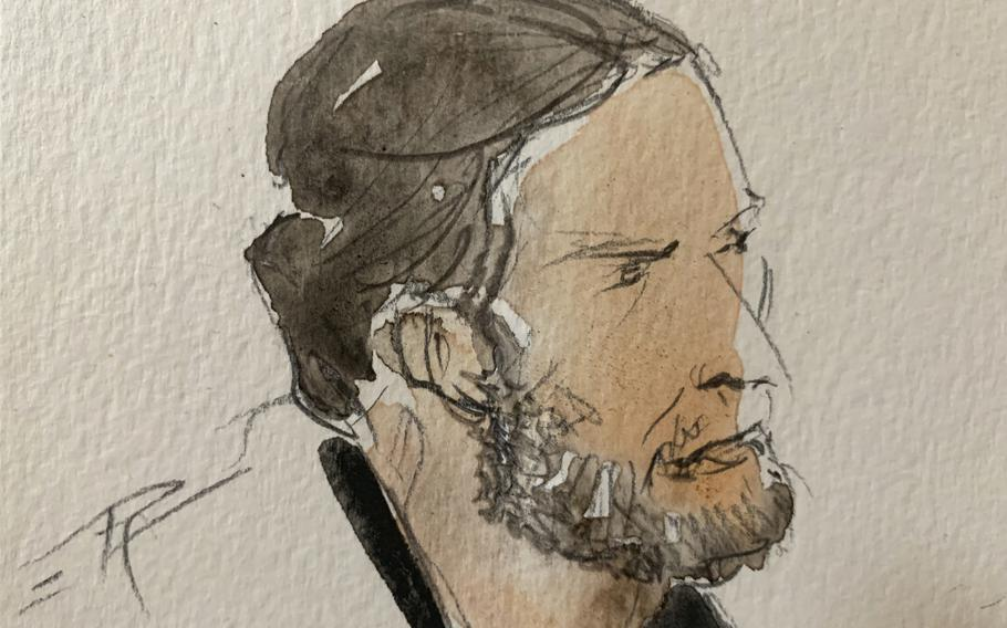 A courtroom sketch shows key defendant Salah Abdeslam, in the special courtroom built for the 2015 attacks trial, in Paris, on Sept. 8, 2021.