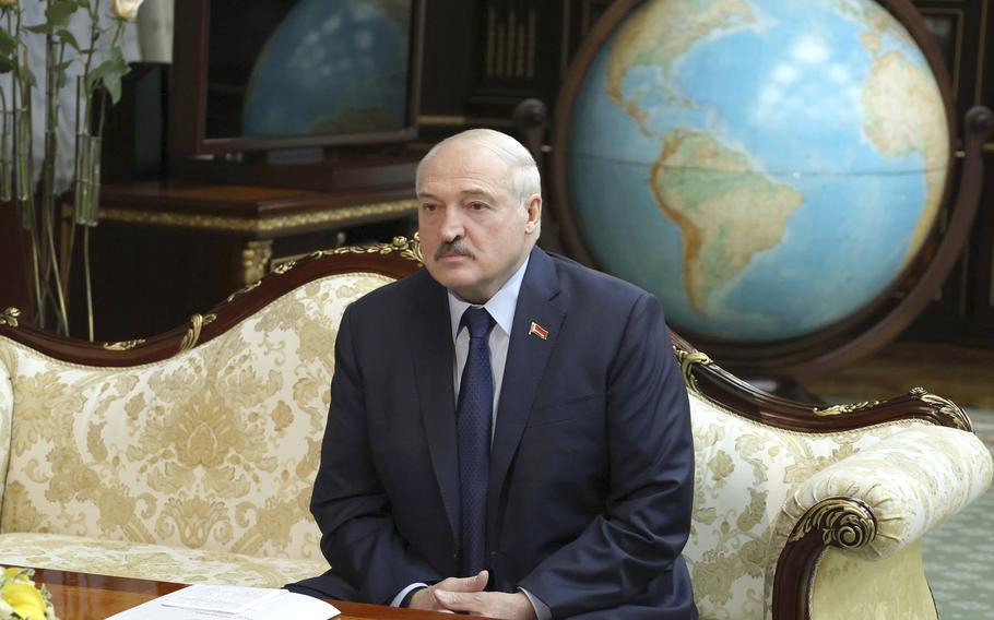 Belarusian President Alexander Lukashenko listens to World Health organization Director for Europe Hans Kluge during their meeting in Minsk, Belarus, Thursday, Oct. 14, 2021.