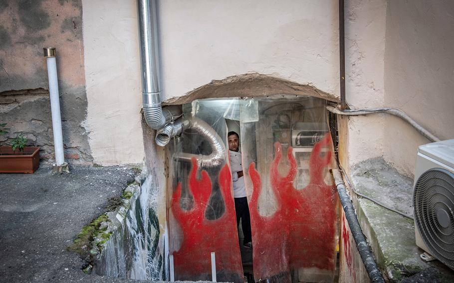 Entrance to a restaurant in Tbilisi, Georgia, on May 12. The restaurant is at the site of Soviet-era cells used to interrogate and torture prisoners, according to the Soviet Past Research Laboratory.