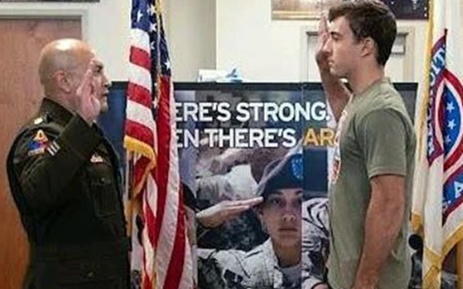 Maj. Miguel Diaz enlists Kheydon Gracie at the Army recruiting office at Huntington Park, Calif. Gracie is the son of Royce Gracie, the first person inducted into the Ultimate Fighting Championships Hall of Fame.