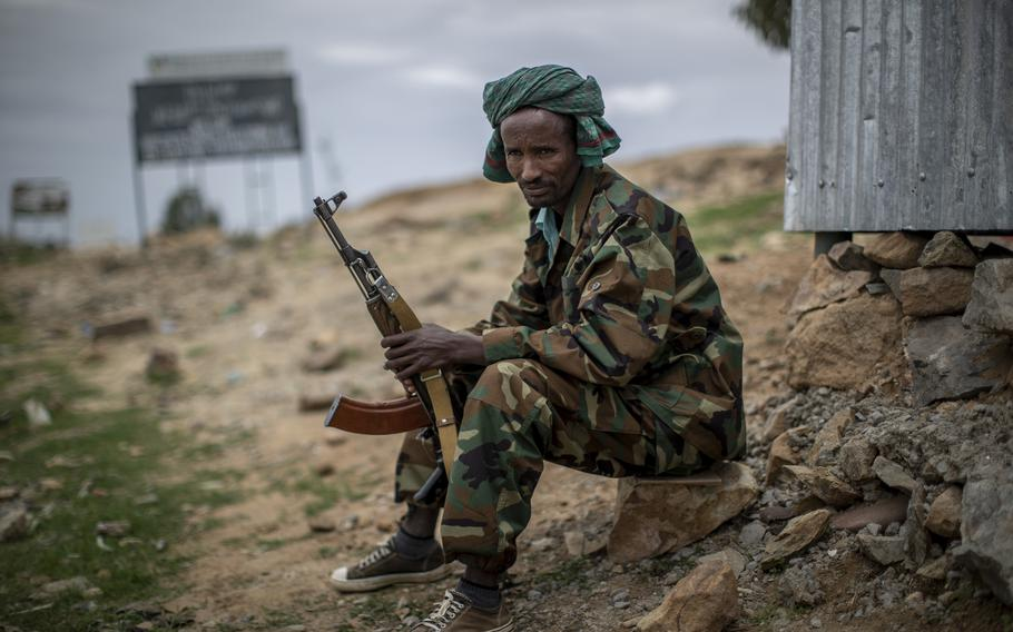 A fighter loyal to the Tigray People's Liberation Front mans a guard post on the outskirts of the town of Hawzen, then-controlled by the group, in the Tigray region of northern Ethiopia, on Friday, May 7, 2021. The battle for Hawzen is part of a larger war in Tigray between the Ethiopian government and the Tigrayan rebels that has led to massacres,gang rapesandthe flightof more than 2 million of the region's 6 million people.